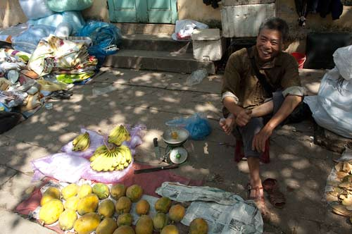 Fruit Vendor at Market