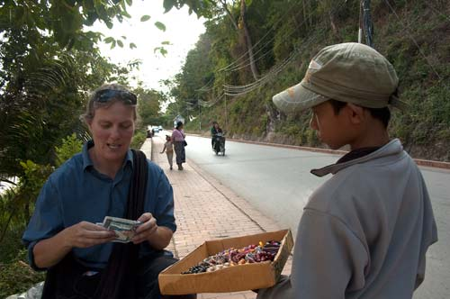 buying from a street vendor, Luang Prabang, Laos