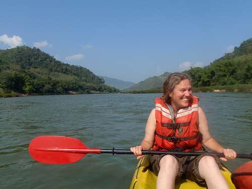 Sue Kronen kayaking on Nam Pa River, Laos