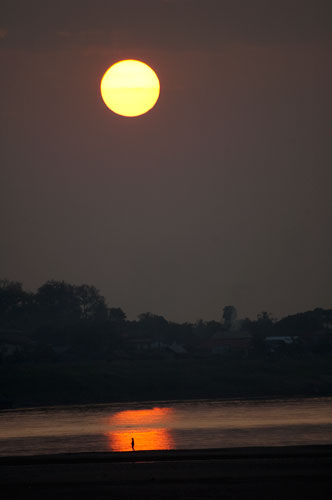 sunset over the Mekong River and Thailand shore, Vientiane, Laos