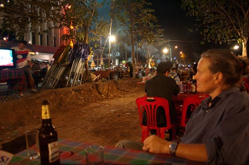 watching football on outdoor TV, Vientiane, Laos