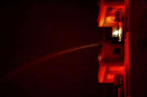 spraying water on warehouse fire on Ngo 175 Cau Giay, Hanoi, Vietnam