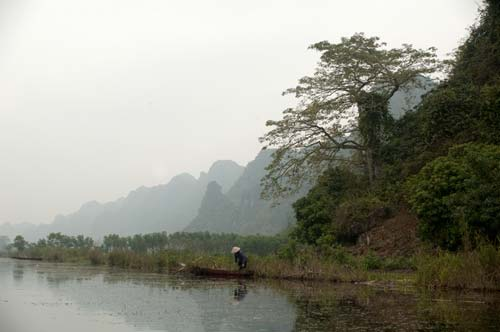 working along the Day River, Vietnam