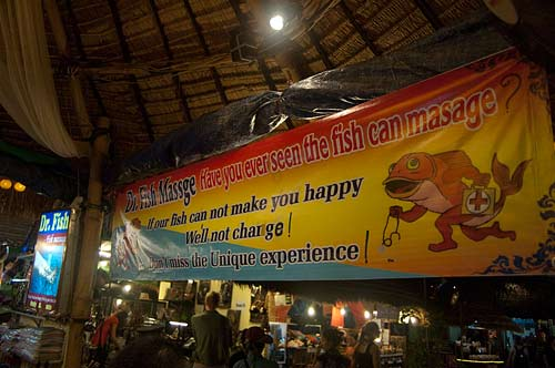 fish massage sign, night market, Siam Reap, Cambodia