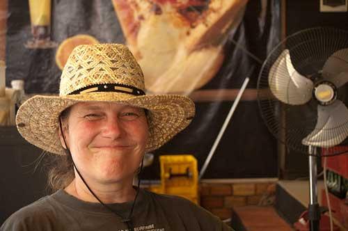 Sue Kronen tries a hat on, Siam Reap, Cambodia