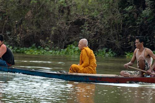 monk in a boat, Sangker River, Cambodia