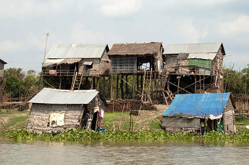 homes on riverbank, Sangker River, Cambodia
