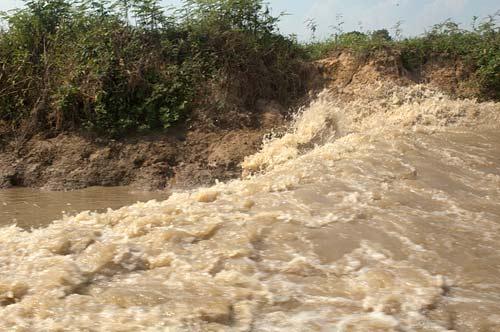 boat wake, Sangker River, Cambodia