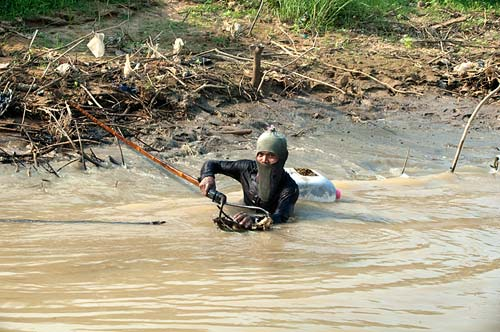 fisherman, Sangker River, Cambodia