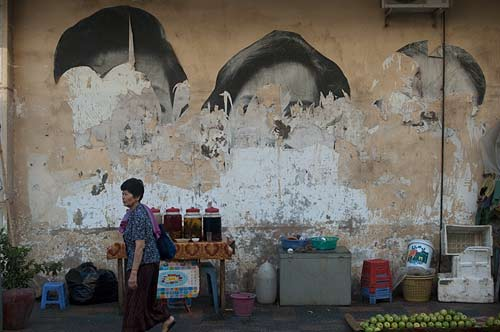 wall with torn posters, Phnom Penh, Cambodia