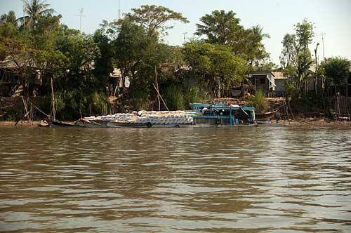 heavily laden boat, Bassac River, Vietnam