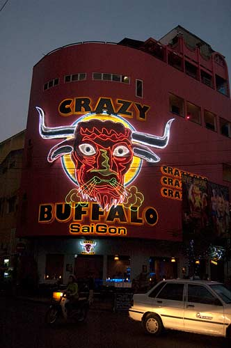 Crazy Buffalo sign by night, Saigon, Vietnam