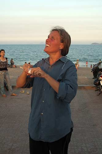 Sue Kronen flying a kite, Nha Trang Beach, Vietnam