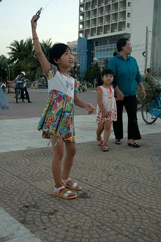 girl with kite, Nha Trang Beach, Vietnam