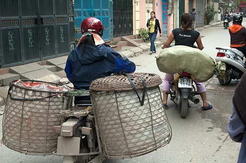 loaded motorbikes, Hanoi, Vietnam