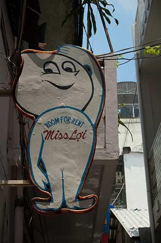 Miss Loi's Guesthouse sign, Saigon, Vietnam