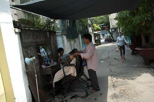 street barber, Saigon, Vietnam