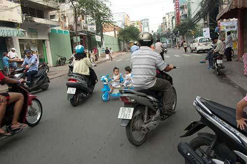 kids learning to ride two wheelers, Saigon, Vietnam