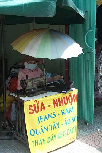 seamstress on street, Saigon, Vietnam