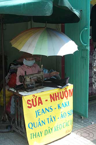 seamstress on street, Saigon, Vietnam