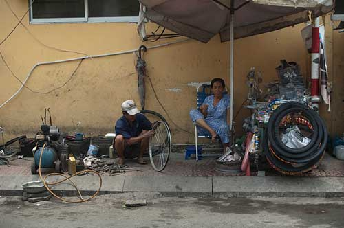 roadside bike repairs, Ho Chi Minh City, Vietnam