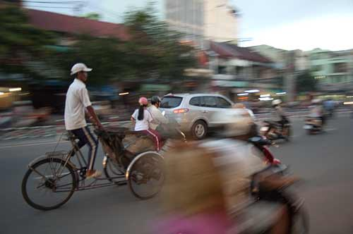 cyclo in rush hour, Ho Chi Minh City, Vietnam