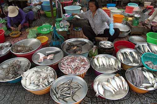 selling fish on the sidewalk, Saigon, Vietnam