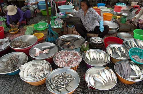 selling fish on the sidewalk, Saigon, Vietnam