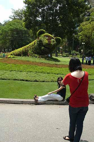 posing for photo, Tao Dan Park, Saigon, Vietnam