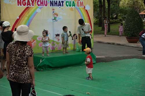 children on karaoke stage, Tao Dan Park