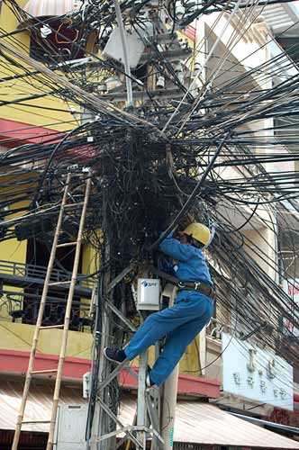 working on electrical wiring, Ho Chi Minh City, Vietnam