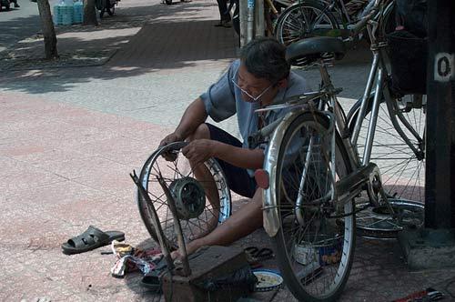 roadside wheel repair, Ho Chi Minh City, Vietnam