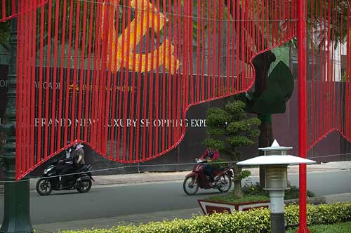contrasting signage, Ho Chi Minh City, Vietnam