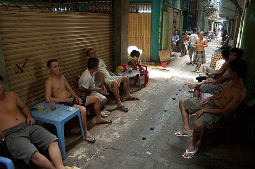 men in Saigon lane, Vietnam
