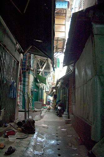 narrow lane in Ho Chi Minh City, Vietnam