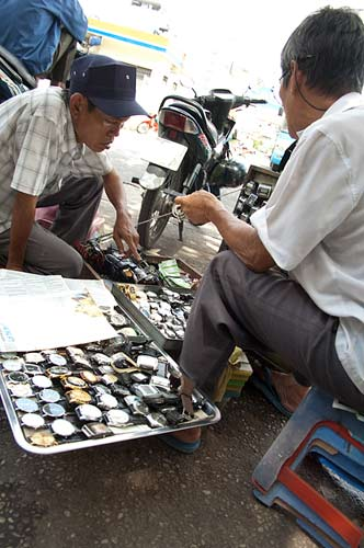 watch sales on the street, Ho Chi Minh City, Vietnam