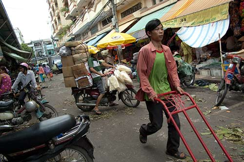 moving goods outside Cho Binh Tay market, Saigon, Vietnam