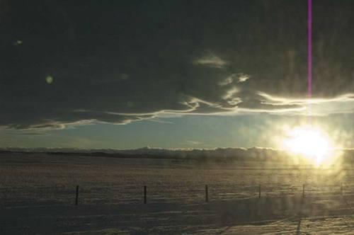 sun sets over the Rocky Mountains, Alberta
