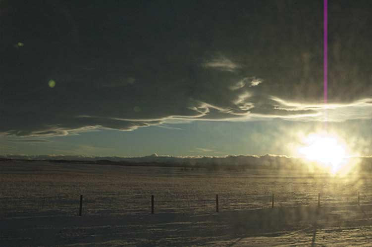 sun sets over the Rocky Mountains, Alberta