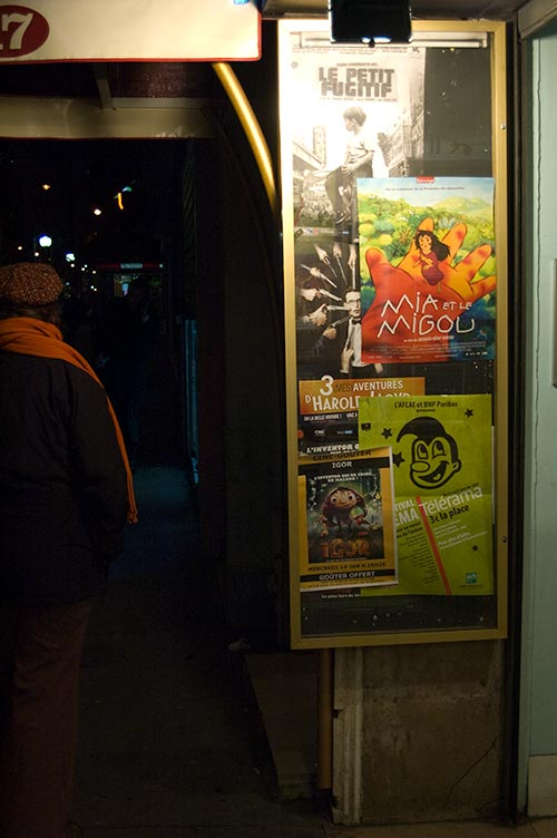 Paris night street scene with posters