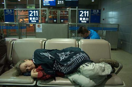Sue sleeping in Shanhai airport
