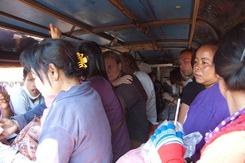 crammed in the back of local transport, Laos
