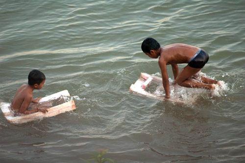boys playing on the Mekong River, Champasak, Laos