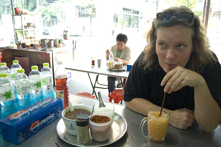 Sue sipping on Thai iced tea, Bangkok, Thailand