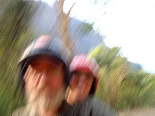 Kelly and Sue riding near Tha Khaek, Laos