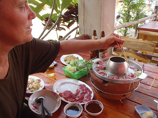 cooking the beef in Nakhon Phanom, Thailand