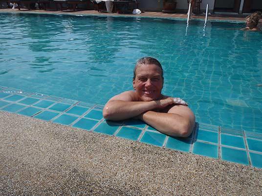 Sue in pool at Rambuttri Village Inn, Bangkok, Thailand