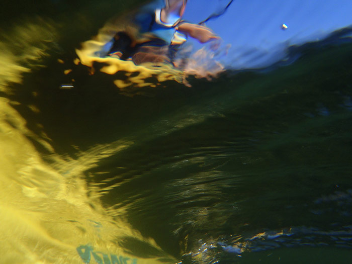 underwater photo of Sue kayaking on Vaseux Lake