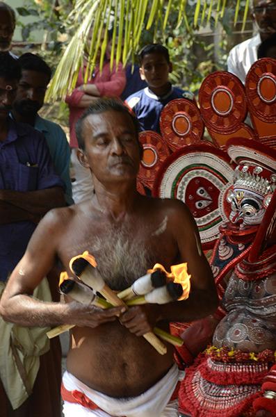 kannur-theyyam-torches