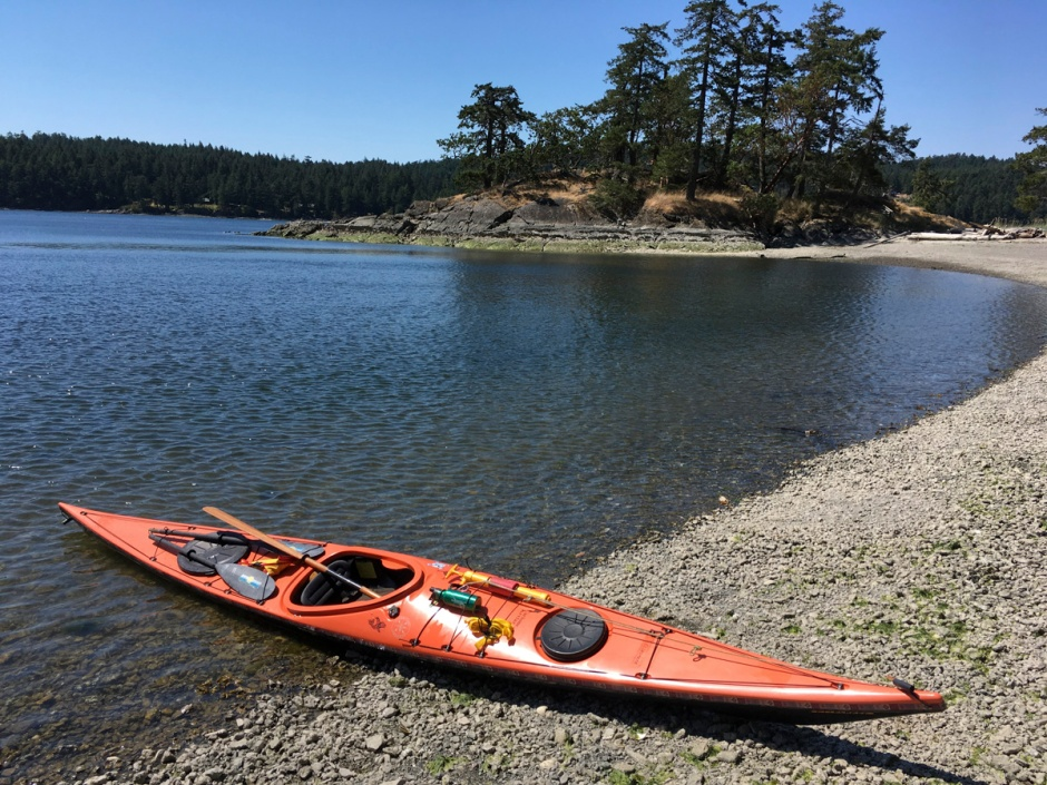 Kayak on beach at Beaumont Marine Park, Pender Island, BC